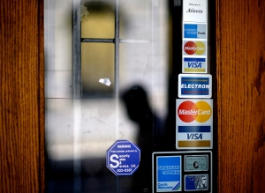 Credit card company stickers on a door. (David Goldman / AP)