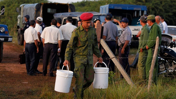 Security and rescue workers work in the area where a Cuban passenger plane crashed in Guasimal, Cuba, Friday Nov. 5, 2010. (AP / Javier Galeano)