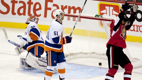 Ottawa Senators' Peter Regin, right, celebrates as teammate Jason Spezza's (not pictured) shot defies New York Islanders' Dwayne Rolson, left, and Frans Nielsen during second period NHL hockey action at the Scotiabank Place in Ottawa on Thursday, Nov. 4, 2010. THE CANADIAN PRESS/Sean Kilpatrick