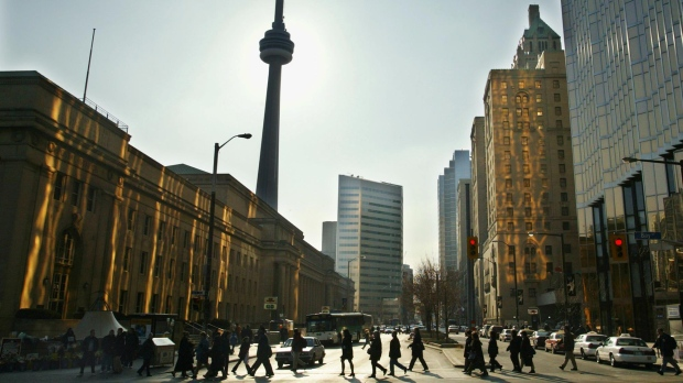 Commuters walk along Bay Street