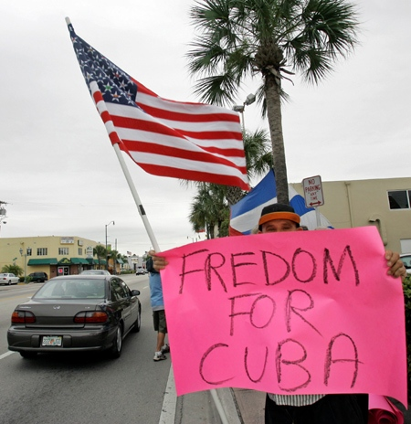 A Cuban-American holds a sign during celebrations in the Little Havana section of Miami on Tuesday, Feb. 19, 2008. (AP / Alan Diaz)
