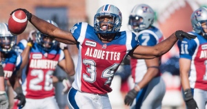 Montreal Alouettes' Kyries Hebert celebrates after intercepting the ball during second half CFL football action against the Saskatchewan Roughriders in Montreal, Sunday, September 16, 2012. THE CANADIAN PRESS/Graham Hughes
