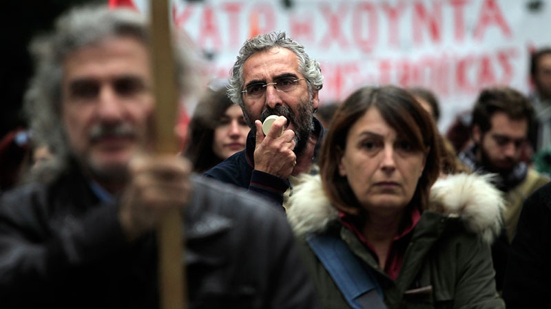 Protesters chant slogans during a union protest in Thessaloniki, Greece, Wednesday, Nov. 14, 2012. (AP / Nikolas Giakoumidis)