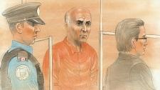 Vakhtang Makhniashvili(centre) wore an orange prisoner's jumpsuit during his appearance in a Toronto court on Friday, Nov. 5, 2010.