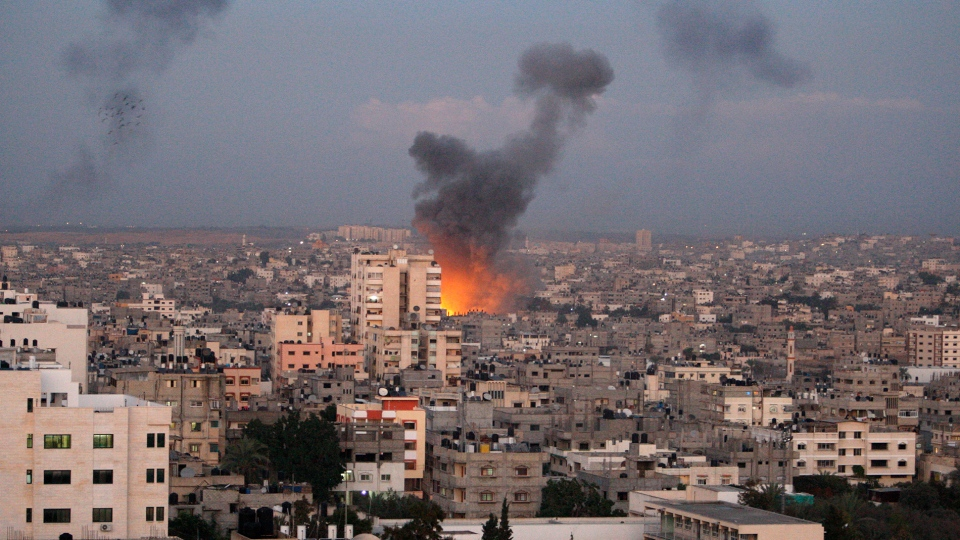 Columns of smoke rise following an Israeli air strike in Gaza City, Wednesday, Nov. 14, 2012. (AP / Adel Hana)