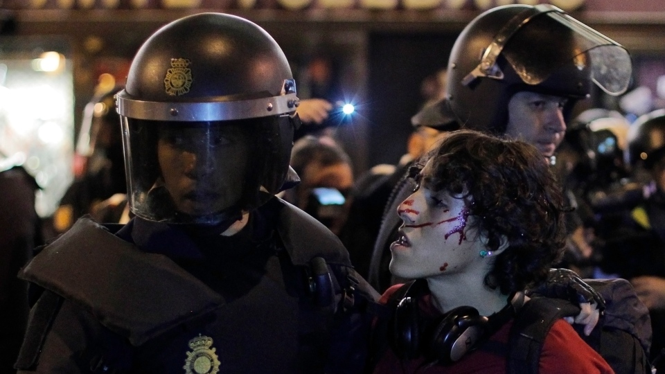 Riot Police arrest a protestor during a general strike in Madrid, Spain, Wednesday, Nov. 14, 2012. (AP / Andres Kudacki)