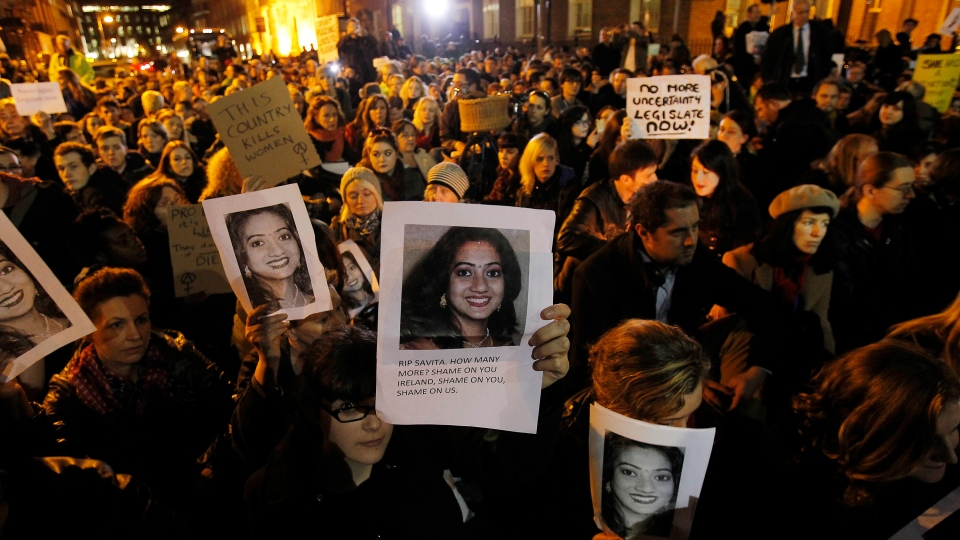 Protestors are shown outside Leinster House in Dublin, Wednesday, Nov. 14, 2012. (AP / Julien Behal, PA)