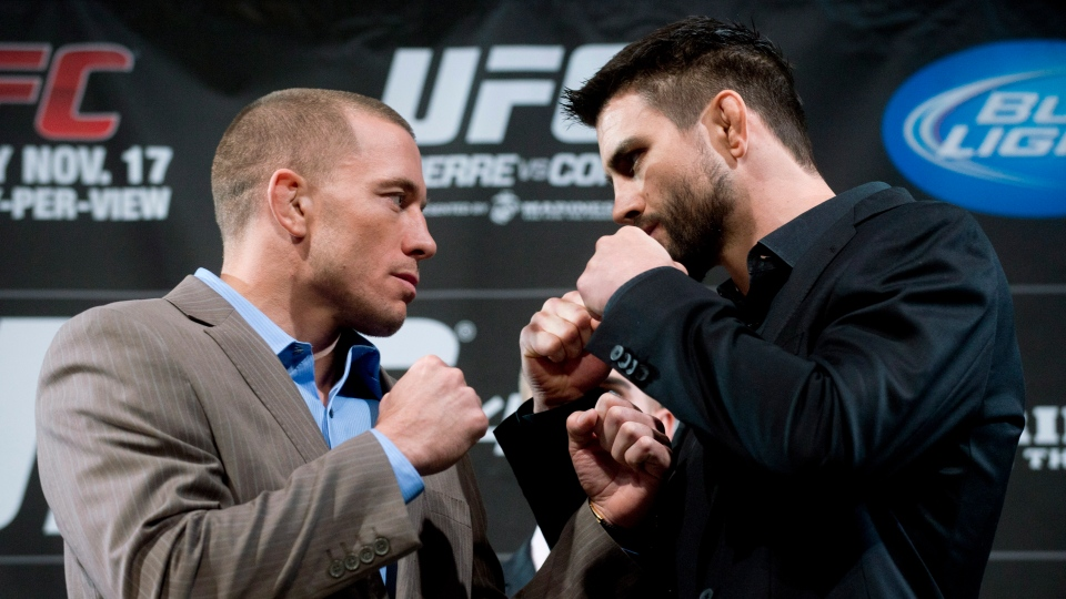 Georges St-Pierre, left, squares off with Carlos Condit following a press conference in Montreal, Wednesday, November 14, 2012, ahead of their UFC 154 title fight which takes in Montreal on November 17. THE CANADIAN PRESS/Graham Hughes.