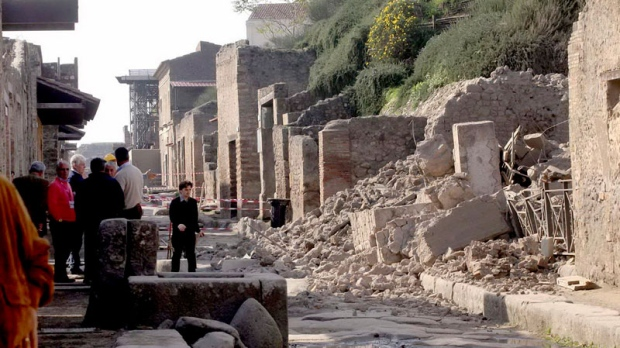 People stand by rubble in the ancient Roman city of Pompeii, Italy, Saturday, Nov. 6, 2010. (AP / Franco Castano)