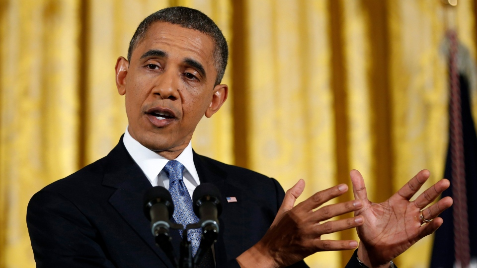 U.S. President Barack Obama gestures as he answers a question during a news conference in the East Room of the White House in Washington, Wednesday, Nov. 14, 2012. (AP / Carolyn Kaster)