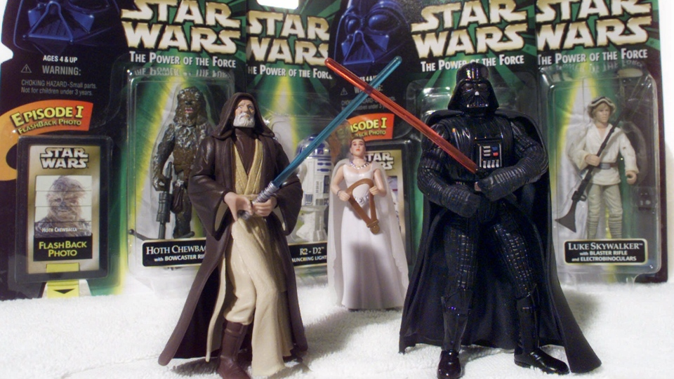 'Star Wars' action figures Darth Vader, right, and Ben (Obi-Wan) Kenobi, left, are displayed with Princess Leia Organa in front of other packaged characters, April 7, 1999. The National Toy Hall of Fame announces its class of 2012 Thursday Nov. 15, 2012. (AP / Victoria Arocho)