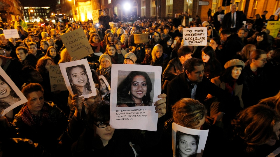 Protestors take a stand against the death of Savita Halappanavar, who died in October after being refused an abortion, outside Leinster House in Dublin on Wednesday, Nov. 14, 2012. (AP / Julien Behal)