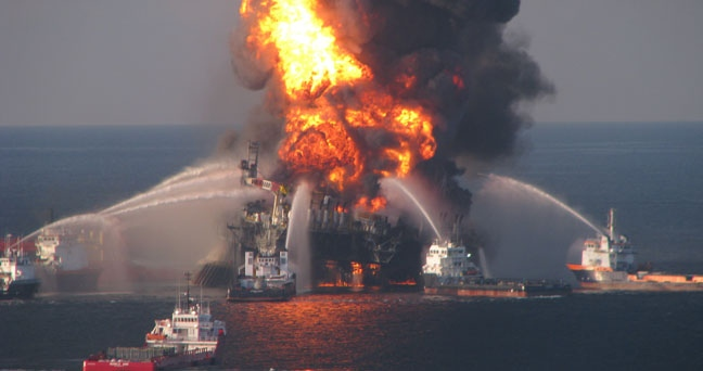 Fire boat response crews battle the blazing remnants of the off shore oil rig Deepwater Horizon, April 21, 2010. (US Coast Guard)