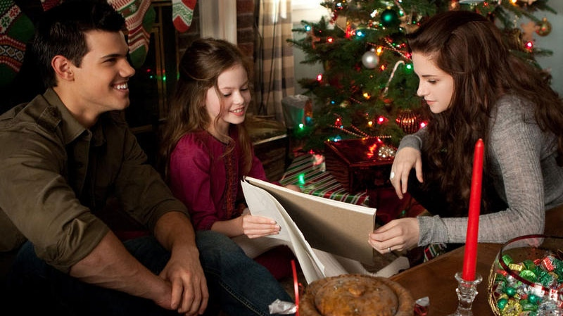 Taylor Lautner, Mackenzie Foy, and Kristen Stewart in a scene from eOne Films Canada's 'Breaking Dawn - Part 2'