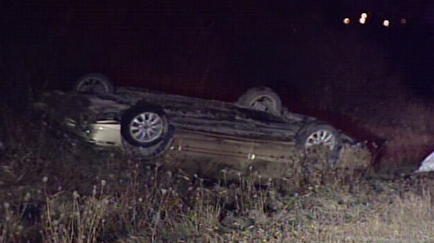 A car lies on its roof after running into a moose on Highway 417 in Ottawa Wednesday, Nov. 14, 2012.