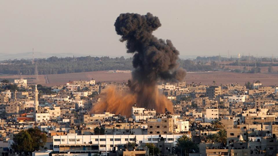 Smoke rises following an Israeli attack on Gaza City, Thursday, Nov. 15, 2012. (AP/ Hatem Moussa)