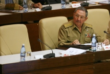 Cuba's acting President Raul Castro sits next to Fidel Castro's empty chair during a session of the National Assembly of Popular Power in Havana, Cuba on Friday, Dec. 28, 2007. (AP / Dado Galdieri)