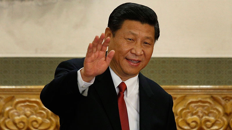 New Communist Party General Secretary Xi Jinping waves in Beijing's Great Hall of the People Thursday, Nov. 15, 2012. (AP / Vincent Yu)