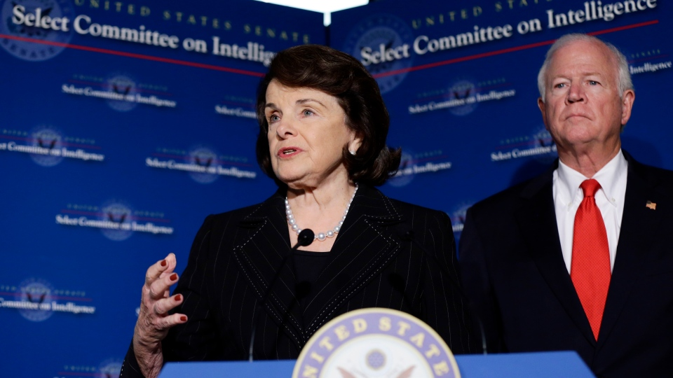 Senate Intelligence Committee Chair Sen. Dianne Feinstein, D-Calif., left, with Senate Intelligence Committee Vice Chairman Sen. Saxby Chambliss, R-Ga., right, speaks during a media availability after a closed-door oversight hearing of the committee on Capitol Hill in Washington, Thursday, Nov. 15, 2012, looking into the circumstances surrounding the deadly attack on the U.S. Consulate in Benghazi, Libya. (AP / Alex Brandon)