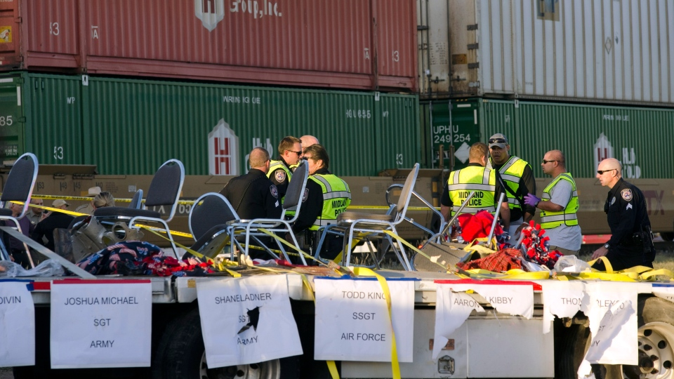 Midland police, fire and sheriffs respond to an accident where a trailer carrying veterans in a parade was struck by a train crossing in Midland, Texas, Thursday, Nov. 15, 2012. (AP / Reporter-Telegram, Tim Fischer)