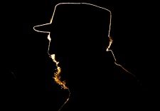 Cuban President Fidel Castro is silhouetted while speaking in Havana in this on Feb. 3, 2006. (AP / Javier Galeano)