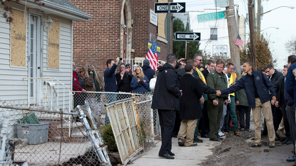U.S. President Barack Obama visits with people on Cedar Grove Avenue, a street significantly impacted by Superstorm Sandy, on the Staten Island borough of New York, Thursday, Nov. 15, 2012. (AP / Carolyn Kaster)