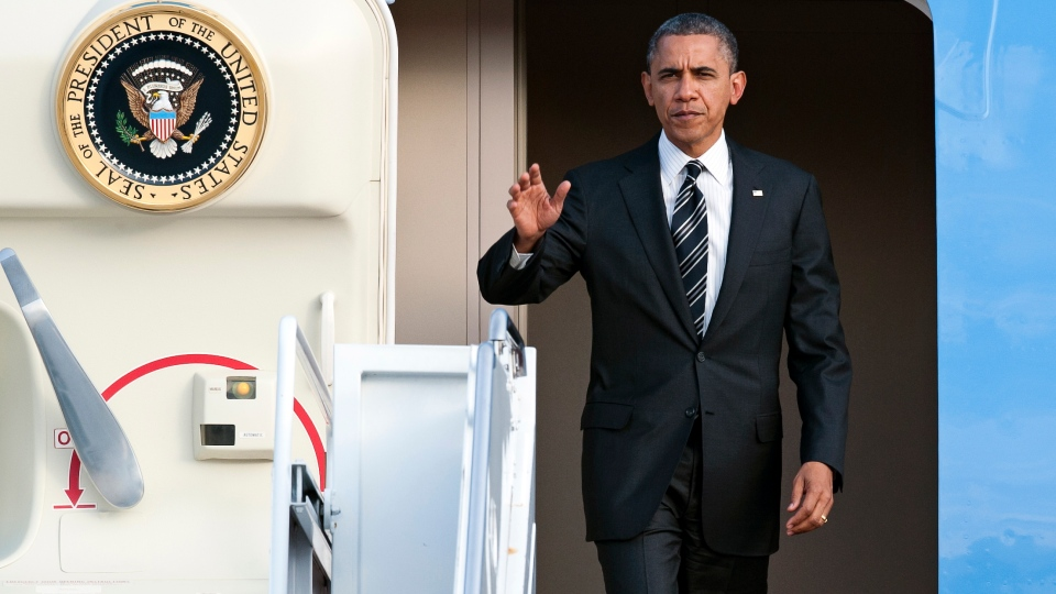 U.S. President Barack Obama waves as he exits Air Force One at Andrews Air Force Base, Md., Thursday, Nov. 15, 2012. (AP / Cliff Owen)