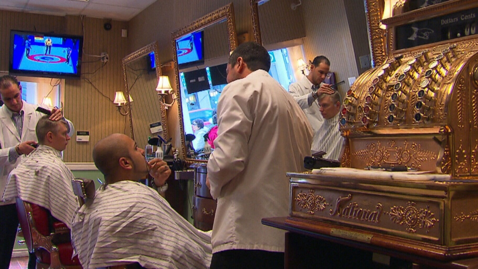 Customers and employees are seen inside of The Terminal Barber Shop in Toronto, Thursday, Nov. 15, 2012.