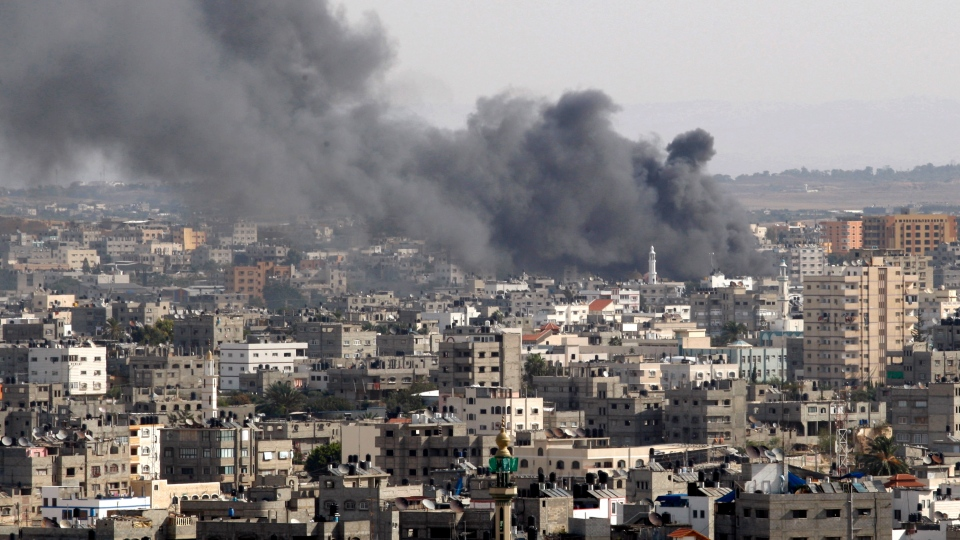 Smoke rises following an Israeli strike in Gaza City, Friday, Nov. 16, 2012. (AP / Adel Hana)