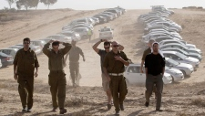 Israeli soldiers border Gaza