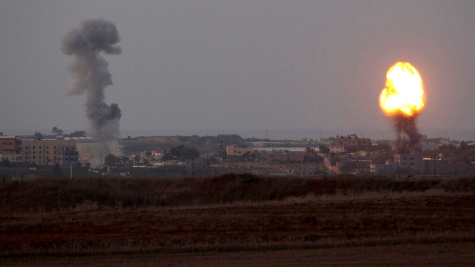Explosion and smoke rise following an Israeli strike in the Gaza Strip, seen from the Israel Gaza Border, southern Israel, Friday, Nov. 16, 2012. (AP / Ariel Schalit)