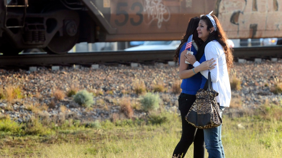Parade participants react after a trailer carrying wounded veterans in a parade was struck by a train in Midland, Texas, Thursday, Nov. 15, 2012. (AP - Reporter-Telegram / James Durbin)