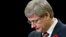 Prime Minister Stephen Harper pauses as he delivers a speech on Parliament Hill in Ottawa on Monday Nov. 8, 2010. (Sean Kilpatrick / THE CANADIAN PRESS)