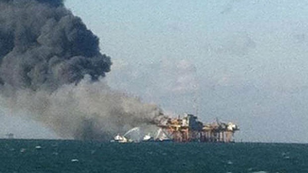 In this image released by a oil field worker, a fire burns on a Gulf oil platform after an explosion on the rig, in the Gulf of Mexico off the Louisiana coast, Friday, Nov. 16, 2012. (AP)