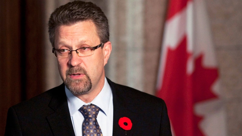 Then-Minister of Transport, Infrastructure and Communities Chuck Strahl speaks to media in the Foyer of the House of Commons on Parliament Hill in Ottawa on Monday Nov. 8, 2010. (Sean Kilpatrick / THE CANADIAN PRESS)