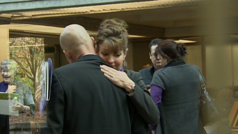 Laurel and Michael Middelaer embrace outside of the sentencing hearing of the driver who killed their daughter. Nov. 8, 2010. (CTV)