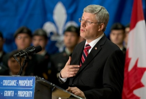 Prime Minister Stephen Harper responds to reporters' questions of the presence of the Canadian flag at the Quebec legislature in Quebec City, Friday, Nov. 16, 2012. (Jacques Boissinot / THE CANADIAN PRESS)