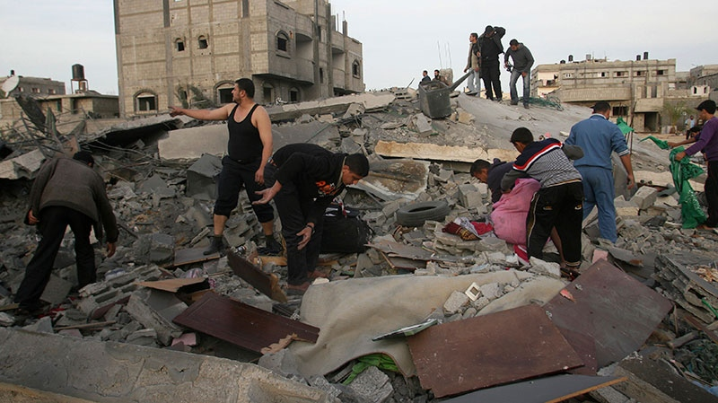 Palestinians inspect the rubble of the destroyed house of Hamas militant Mohammad Abu Shmala, following an Israeli air strike in Rafah, southern Gaza Strip, Friday, Nov. 16, 2012.(AP / Eyad Baba)