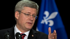 Harper sidesteps flag issue in Quebec