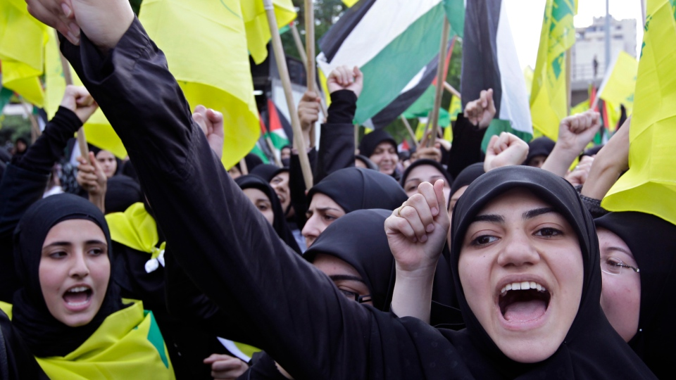 Hundreds of people take part in a protest and shouts slogans against the Israeli offensive in Gaza organized by Palestinian groups in Lebanon and the Lebanese militant Hezbollah group, near the U.N. headquarters in Beirut, Lebanon, Saturday, Nov. 17, 2012. (AP Photo/Bilal Hussein)