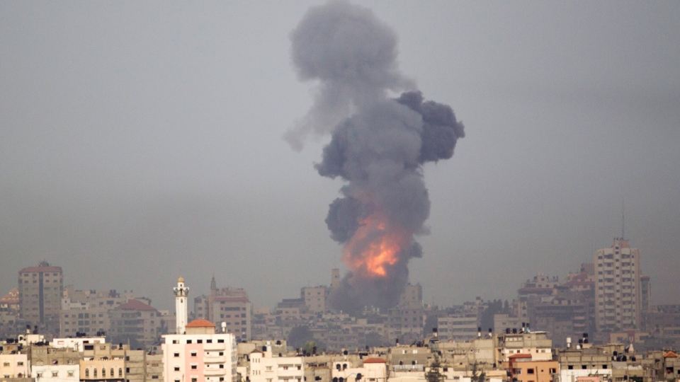 Explosion and smoke rise following an Israeli strike in Gaza, seen from the Israel Gaza Border, southern Israel, Saturday, Nov. 17, 2012. (AP Photo/Ariel Schalit)