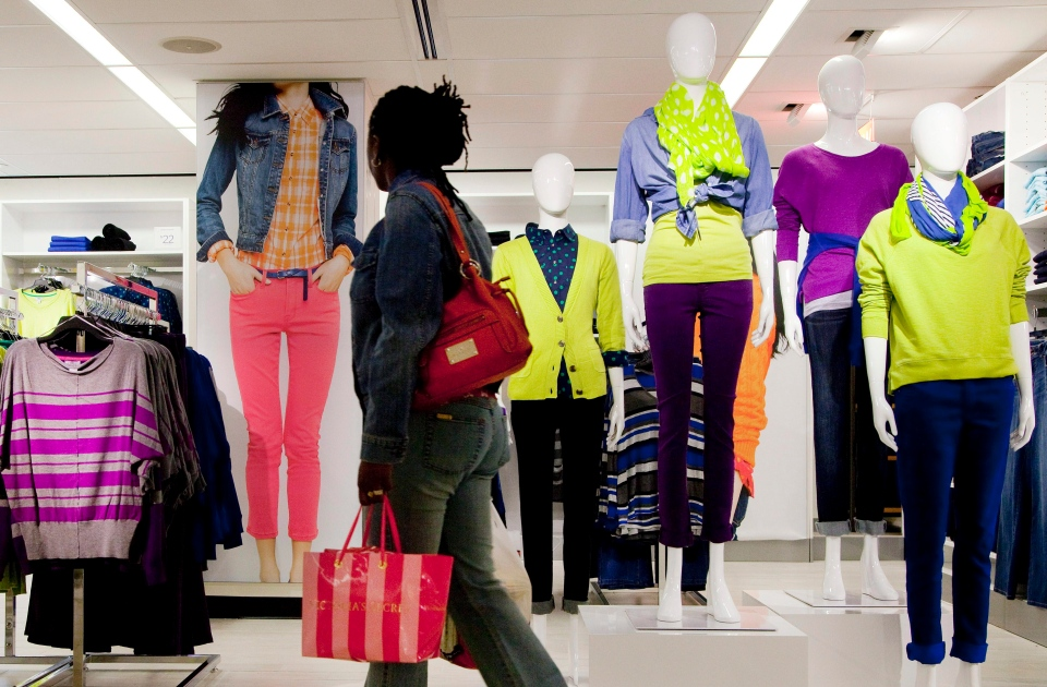 A customer passes merchandise at a J.C. Penney store in New York,  Friday, Oct. 12, 2012. (AP / Mark Lennihan)