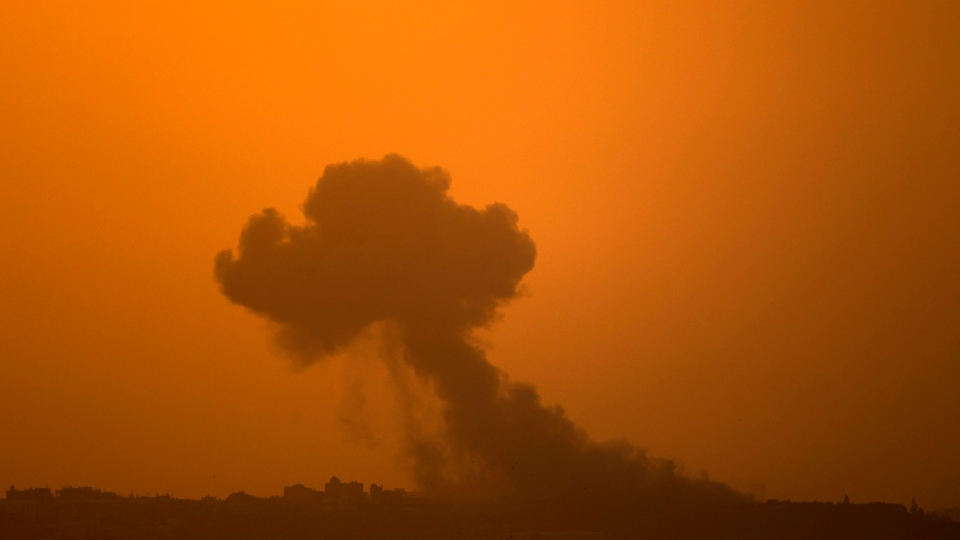 Smoke rises following an Israeli strike in Gaza as seen from the Israel Gaza Border, southern Israel on Saturday, Nov. 17, 2012. (AP / Ariel Schalit)