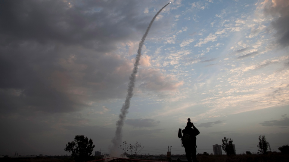 An Iron Dome missile is launched in Tel Aviv, to intercept a rocket fired from Gaza, Saturday, Nov. 17, 2012. (AP / Oded Balilty)