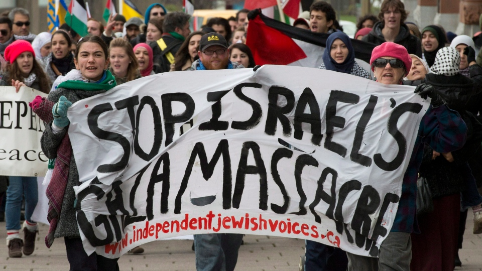 Demonstrators protest ongoing Israeli attacks on Gaza, as they march through the streets of Ottawa on Friday, Nov. 16, 2012. (Adrian Wyld / THE CANADIAN PRESS)