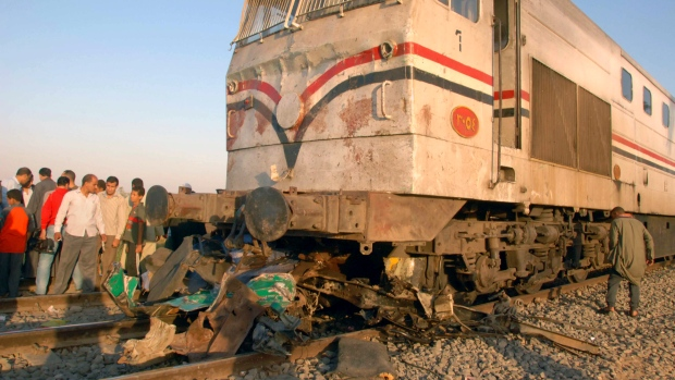 Egyptians gather at the site of a train crash that killed at least 49 people, most of them children between 4 and 6 years old near Assiut in southern Egypt, Saturday, Nov. 17, 2012. (AP)