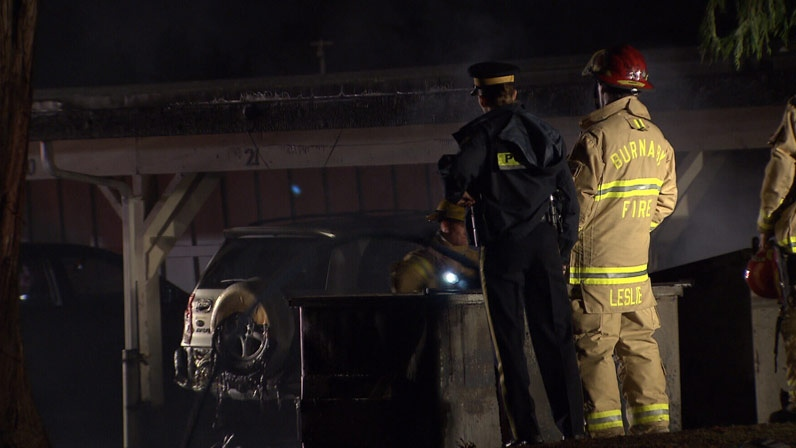 A fire that broke out behind a Burnaby apartment complex has destroyed the parking lot and eight cars. November 16, 2012. (CTV)