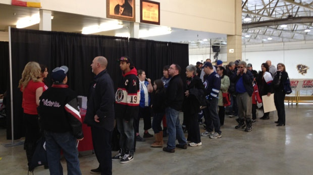 Winnipeggers line up to see NHL players and Winnipeg police officers face off on the ice Saturday.