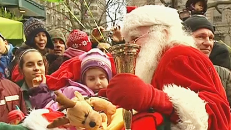 FILE PHOTO: Santa Claus mingled with his starstruck fans in Montreal's 2012 parade.