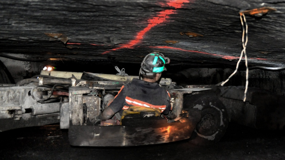 A coal miner drives a scoop while working in the Tech Leasing and Rebuild Inc. Mine #1 in Buchanan County, Va., April 2010. (Bristol Herald Courier, David Crigger)